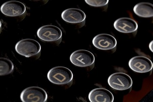 Close up photo of antique typewriter keys with dust, shallow focus